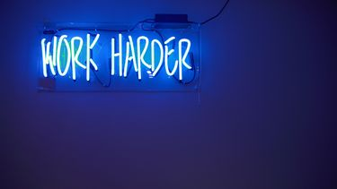 neon lights saying Work harder